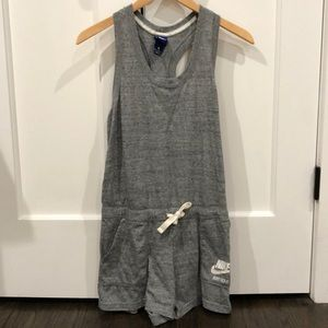 Preowned Gray Nike Romper Size Medium fits Small